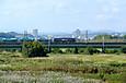 「多摩川を渡る米タン」